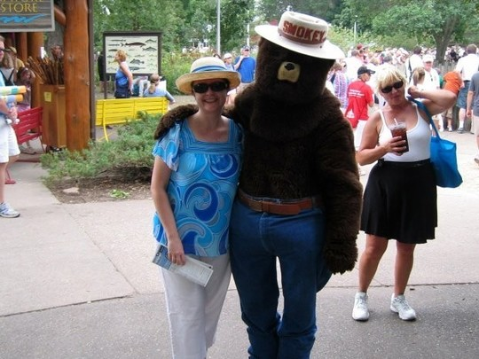 Smokey Bear with a fairgoer