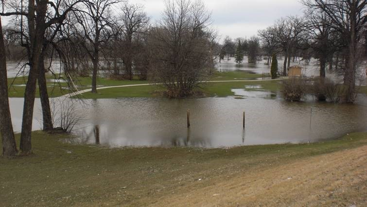 Photo of flooded park in East Grand Forks in former residential neighborhood