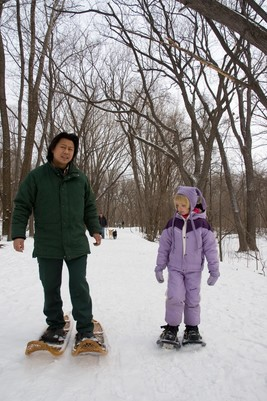 naturalist and child snowshoeing