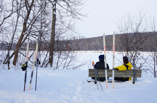 Skiers at Wild River State Park resting on bench