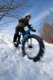 Fat biker on snow-covered trail
