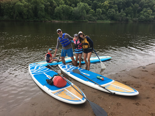 family with paddleboards