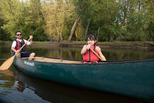 Dad and daughter paddling