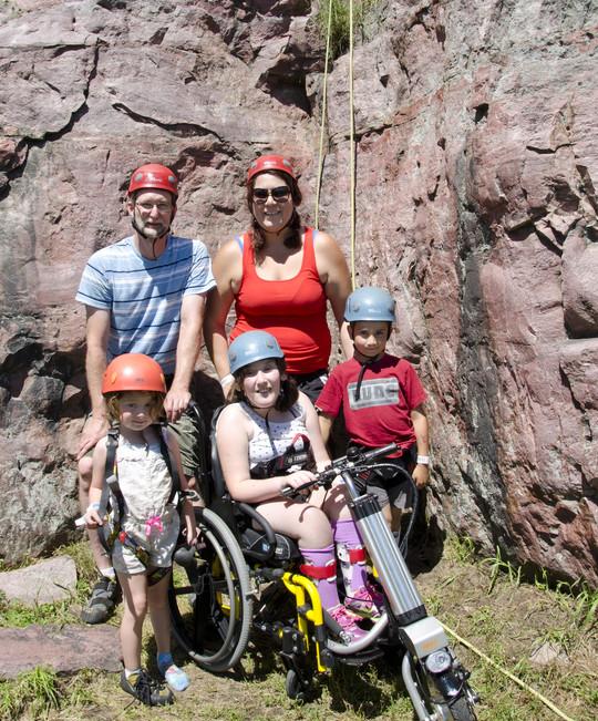 Family at climbing wall