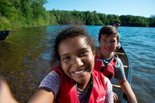 Two kids on canoe