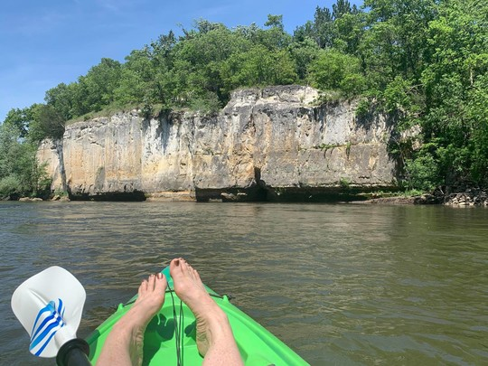 Kayak bow with feet and bluffs