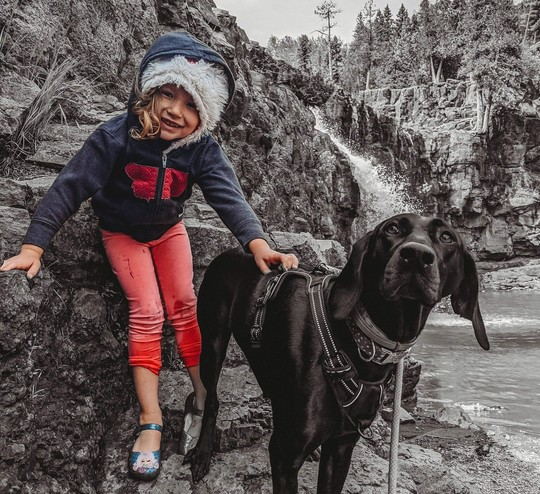 Young girl with dog outdoors