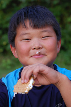 Boy eating s'more