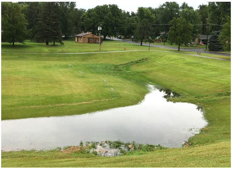 Ponding basin with water after several inch rain