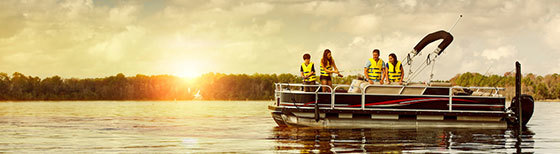 Family on pontoon boat near sunset
