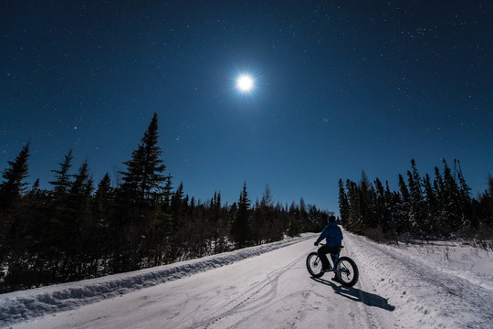 Moonlight ride with fat bike on snow