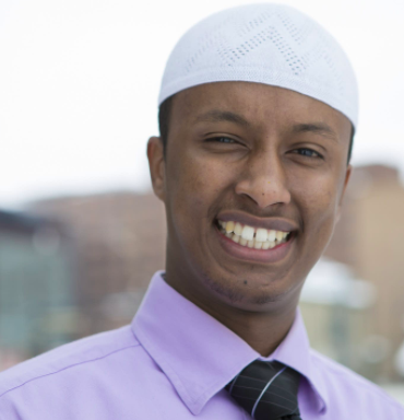 Photo of smiling man with white cap