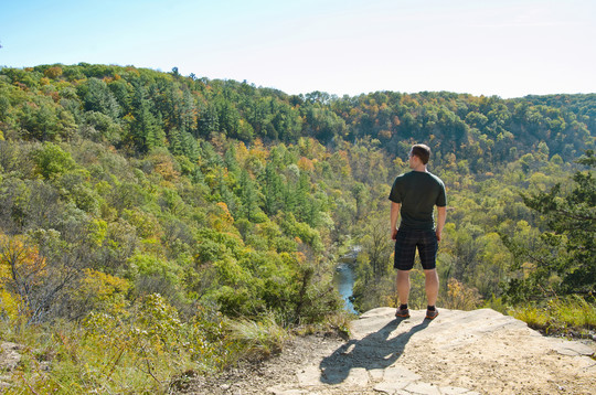 Man with dog standing atop Whitewater overlook