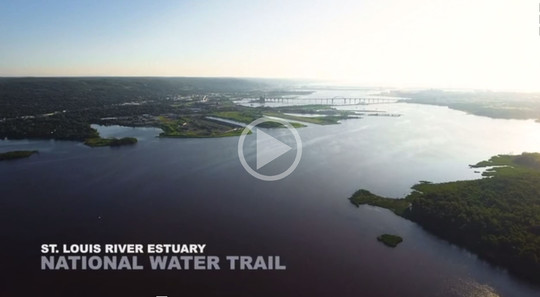 Aerial image of St. Louis River Estuary with the text St Louis River Estuary, National Water Trail and a symbol representing it links to a video.