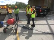 Crew repairing a pothole.