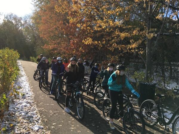 Group of people biking in the winter