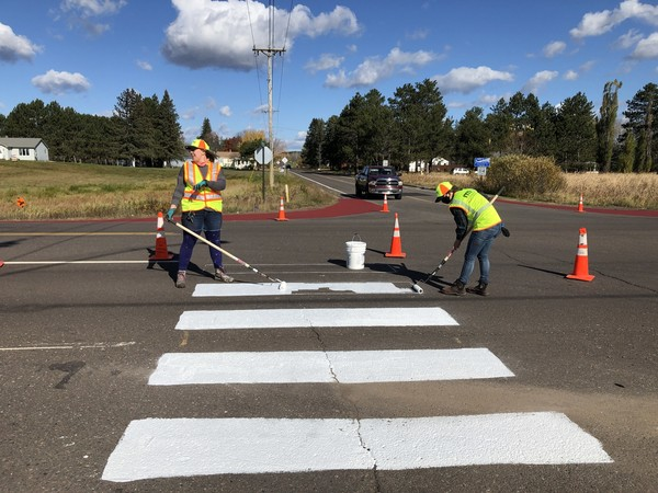 Crosswalk being painted on a road