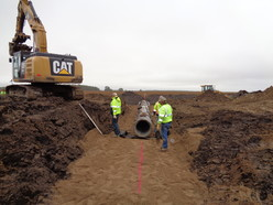 Workers install a new culvert.