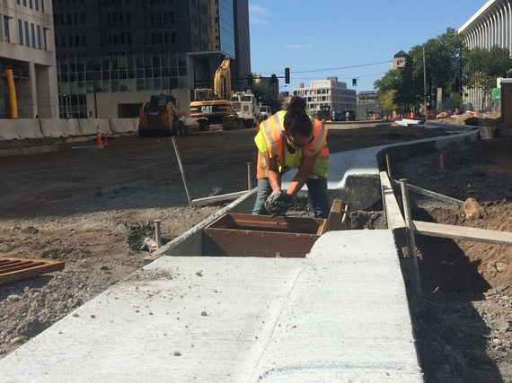 A worker installs a new catch basin