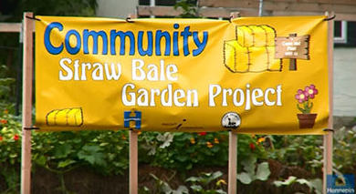 straw bale community garden sign