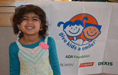 child and Give Kids a Smile poster