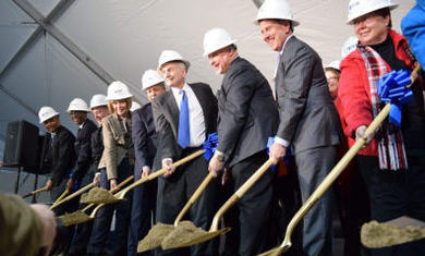 officials and shovels at groundbreaking