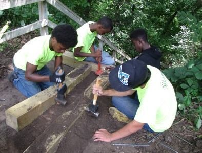 Local youth construct new stairs as part of the Tree Trust youth employment program