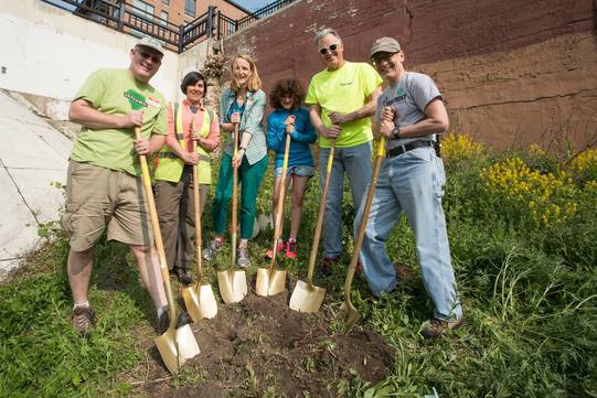 Hennepin County Commissioners Greene and McLaughlin join volunteers at the 2016 Midtown Community Works Arbor Day event.