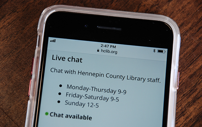 Smart phone screen displaying chat with library