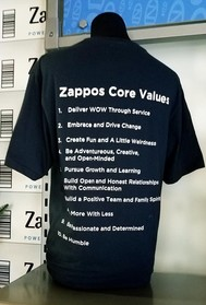 Photo of a Zappos company shirt that has Zappos Core Values listed on the back
