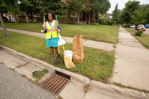 Woman getting ready to clean storm drain