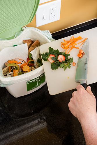 Scraping veggie scraps into organics