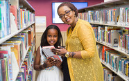 Parent and child selecting a book