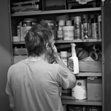 Man looking overwhelmed at garage shelves