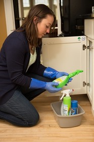 Woman looking at cleaning products