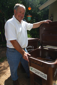 Resident with organics recycling cart