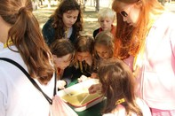 Students looking at macroinvetebrates at Children's Water Festival