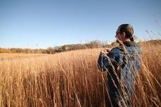 Dave Thill standing in restored prairie