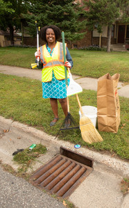 Woman ready with her gear to clean her storm drain