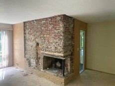 Fireplace with bricks removed through deconstruction