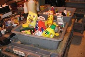 bucket of pesticide bottles