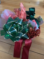 Bows and ribbons saved for reuse in a basket