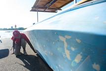 Inspector looking at boat for aquatic invasive species