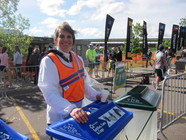 Master Recycler/Composter volunteer at recycling bin
