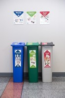 Business recycling bin setup with trash, recycling, and organics