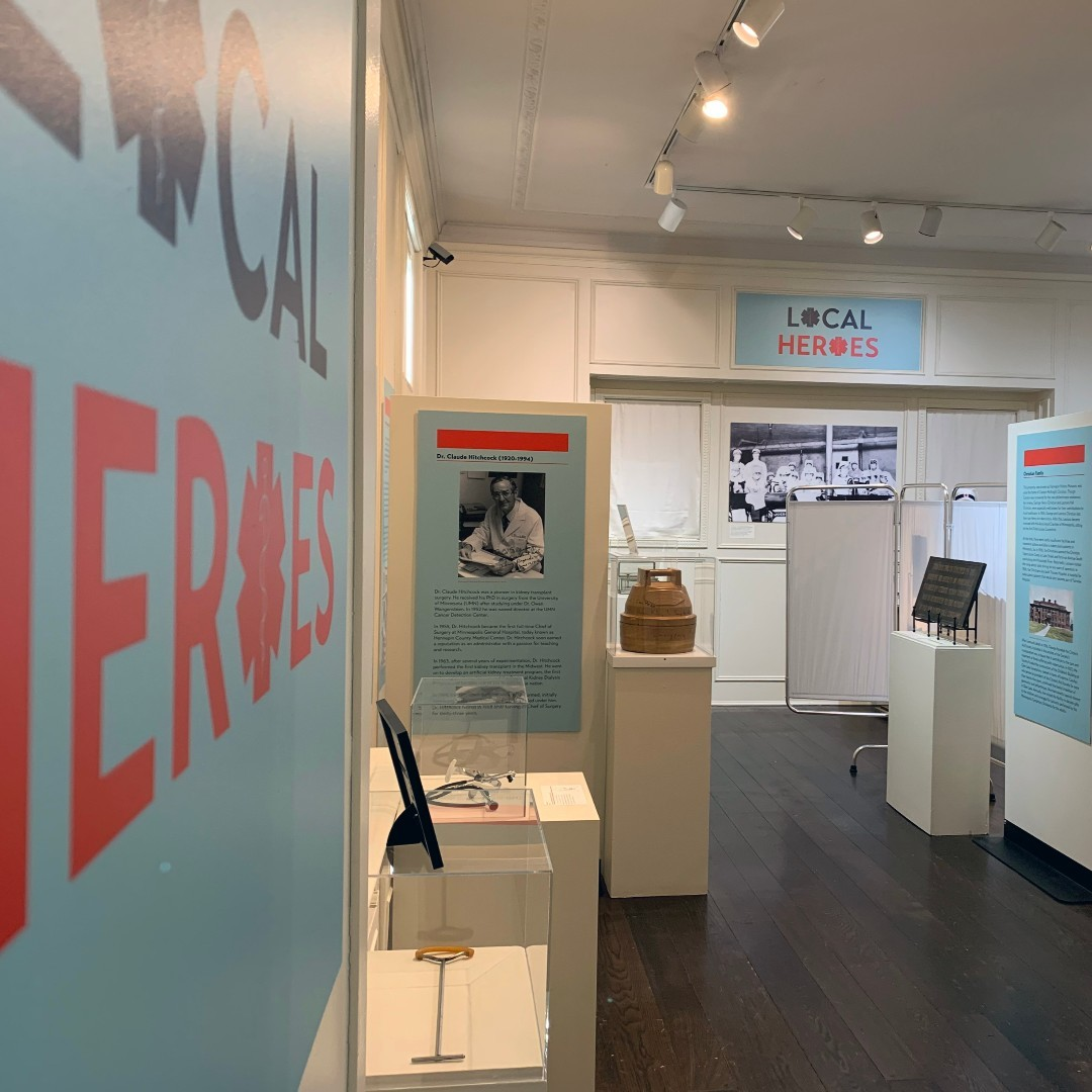Room with artifacts and descriptions of a local heroes exhibit