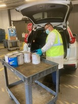 Staff unloading car at drop-off facilities