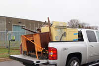 Pickup truck loaded with furniture to drop off at city cleanup event