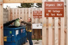 Woman recycles