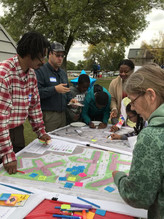 Residents of an apartment complex providing feedback on the design of a landscaping project